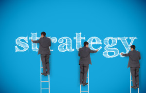 Multiple image of businessman writing strategy