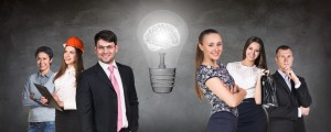 Business people team near big bulb