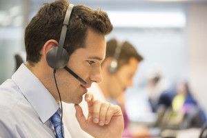 Call center team at office on the phone with headset