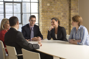 Business executives talking in a meeting