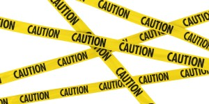 Yellow and Black CAUTION Barrier Tape Background